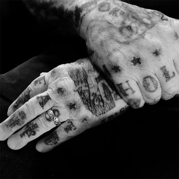 Tattoo legend charlie cartwright with tattooed hands